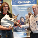 """Kiwanian Bill Wright presents the """"You Make A Difference"""" award to Scott Edwards who is holding Joey."""