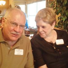 CT Robertson, left, and Brenda McKenzie enjoy an Anzac Biscuit.