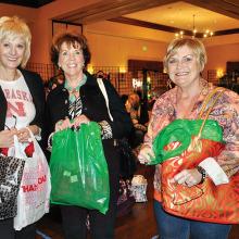 Linda Strader, Mary Ann Carrol and Sharon Foy enjoy a day of shopping at the Holiday Market.