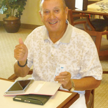 George Bowdouris gives the thumbs up signal after successfully connecting both an iPad and a Kindle Fire.
