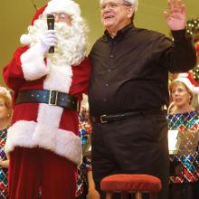 Santa Claus and Musical Director Joe Arnett. Photo by Randy Hatcher.