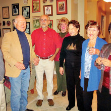 Left to right: Mike Aramanda, Alfred Wright, Pete Toppan, Kathy Perry, Millie Aramanda, Cherie Snowden and Rupa Mathur gather for a holiday toast.