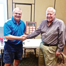 Mark Musgrove, Woodworker of the Year, is being congratulated by our current president, Joey Misiaszek.
