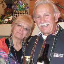 Pam and Wayne Casalino make a clean sweep at the Tuesday Taster's Mardi Gras celebration. They chose the winning wine and Pam found the baby in the King Cake!