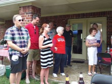 Marguerite Richardson leads guests in singing God Bless America.
