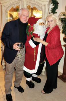 Al and Vivian Wright and Santa greet their guests.