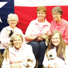 Holding baby goats, back row: Melba Beckham, Nancy Thomas, Cathy Harden; front row: Christine Kidder and Jill SanMiguel
