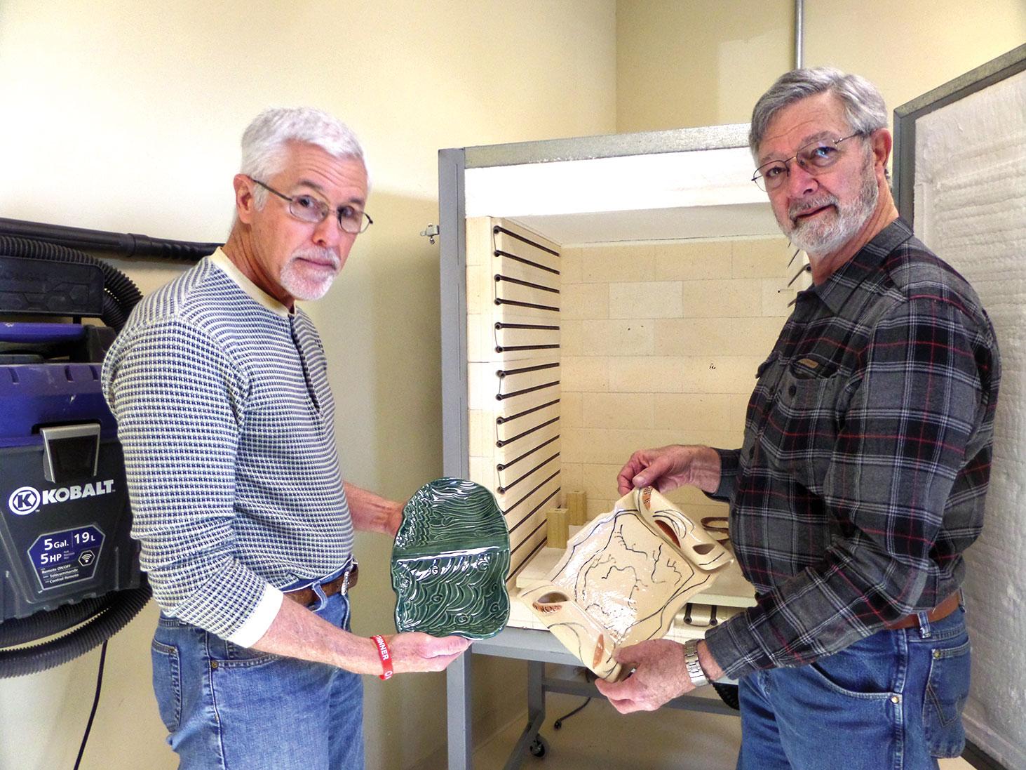 Gary Treibsch and Wayne Detjen unload one of three kilns; always something new!