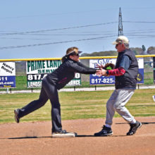 Janet Elizondo puts the tag on a surprised Carlos Muniz at second base.