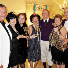 Wine Tasting winners, second place: Michael Gilberti, Nancy Toppan and Terry Gilberti; first place: Catherine and Ken Bass; third place: Mary and Roy Bryant