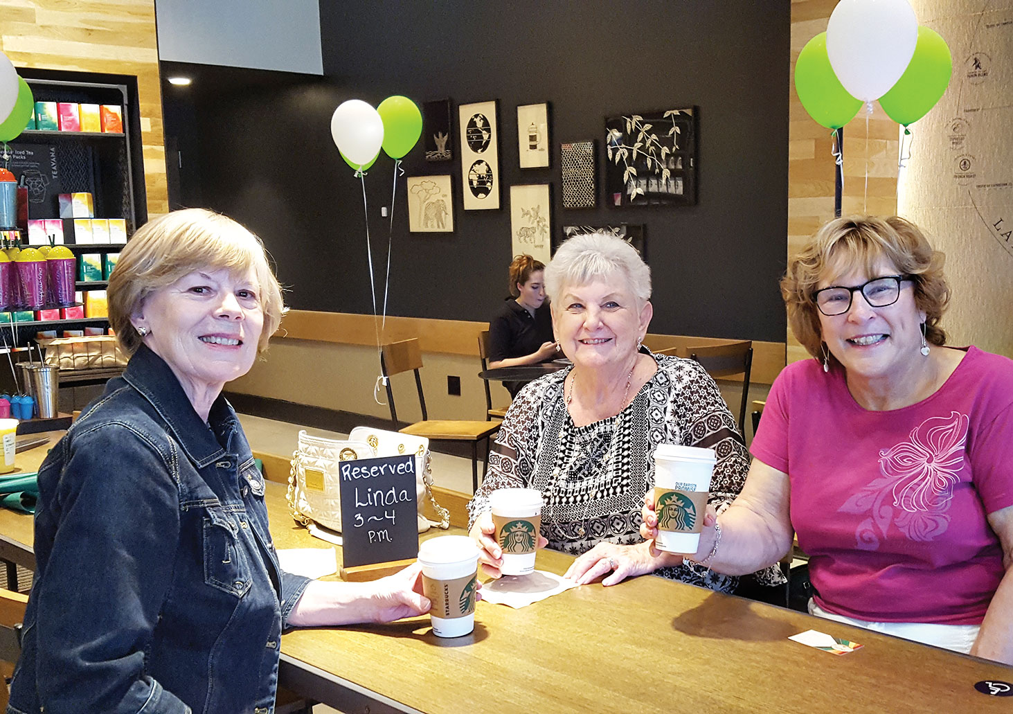 Starbucks - Rosemary Weinstein, Jan Utzman and Linda Terry join in the ribbon cutting ceremony for the Argyle Chamber of Commerce.