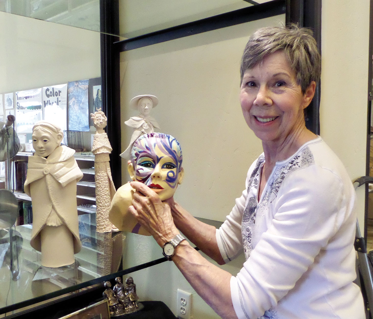 Judie Smothers arranges window