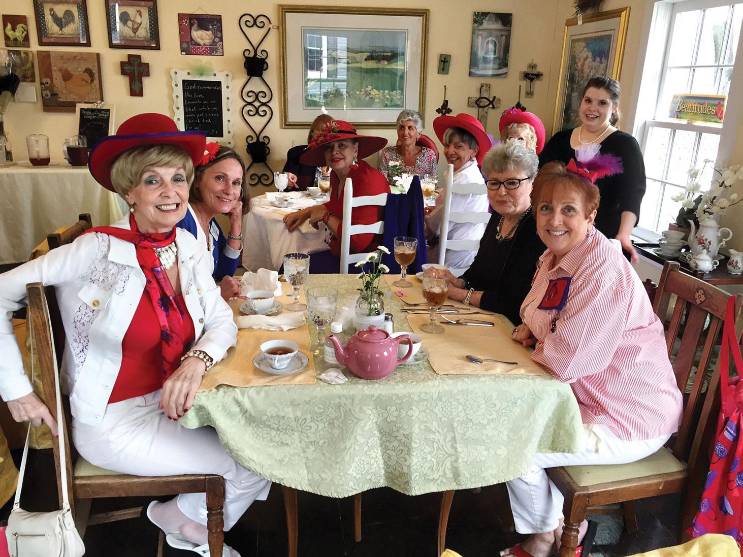 The Ladies with Hattitude enjoying their tea