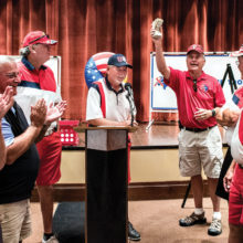 Doyle Hicks, center, presents $1,219 cash donation to SOT