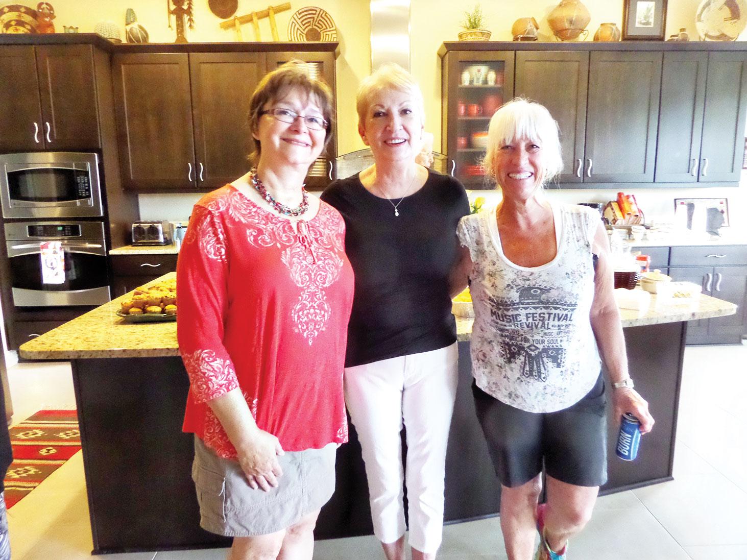 Shirley Waterhouse, Bert Duplantis and Barbara Shippy wait in line for food.