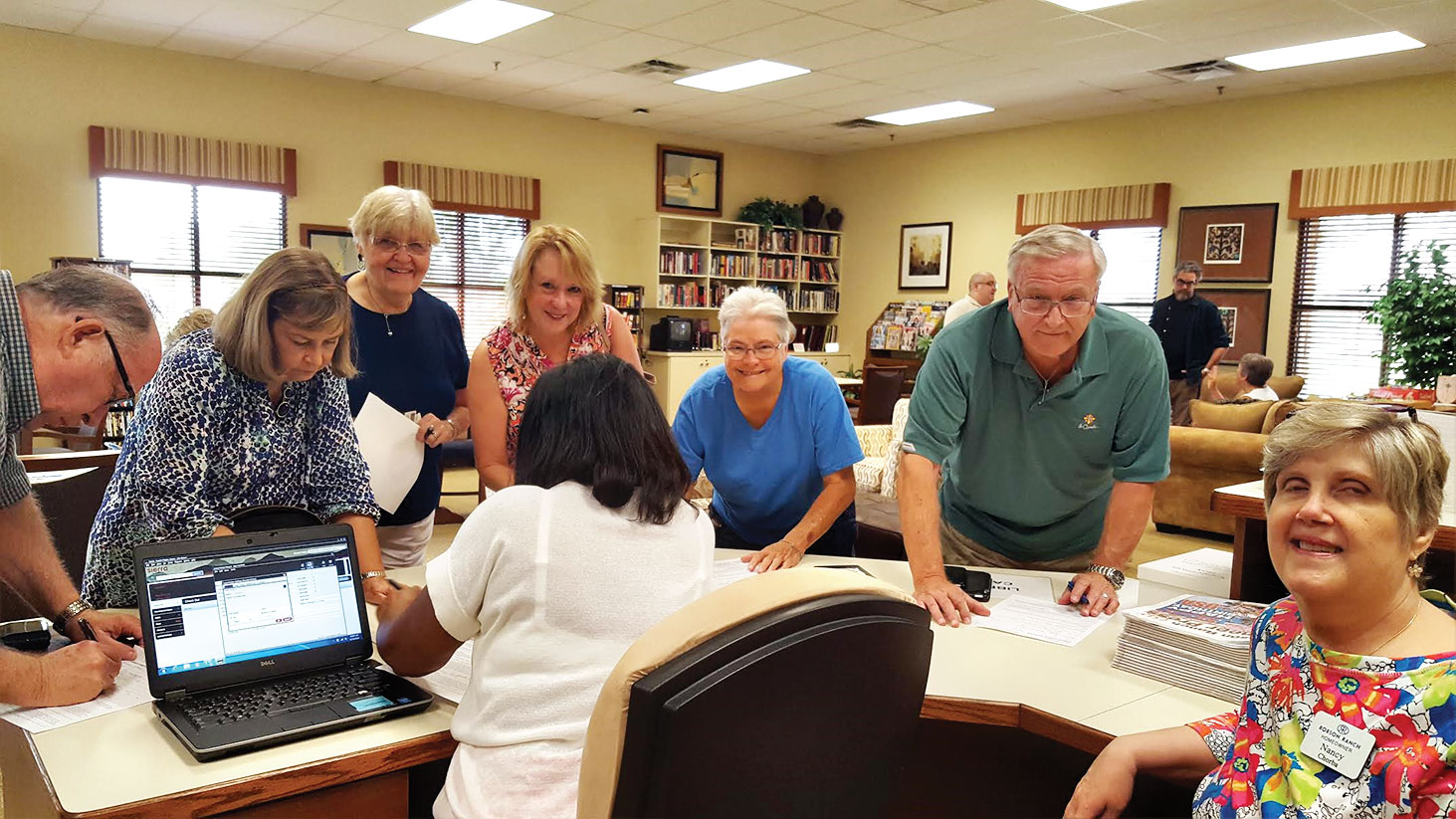 What a line for registering or renewing Denton library cards! Library board member Nancy Chorba manned our local circulation desk while the city library clerk handled the paper work.