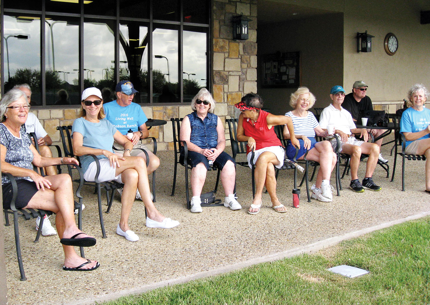 The gallery watching from the Fitness Center patio