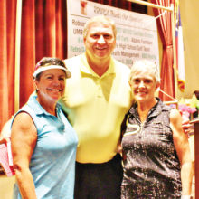 Hole-in-One winner Pam Melton with David Thatcher and Joyce Marshall