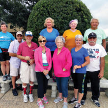 Living Well walkers taking steps toward health and wellness