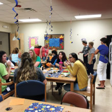 Teachers and staff enjoy a Subway lunch.