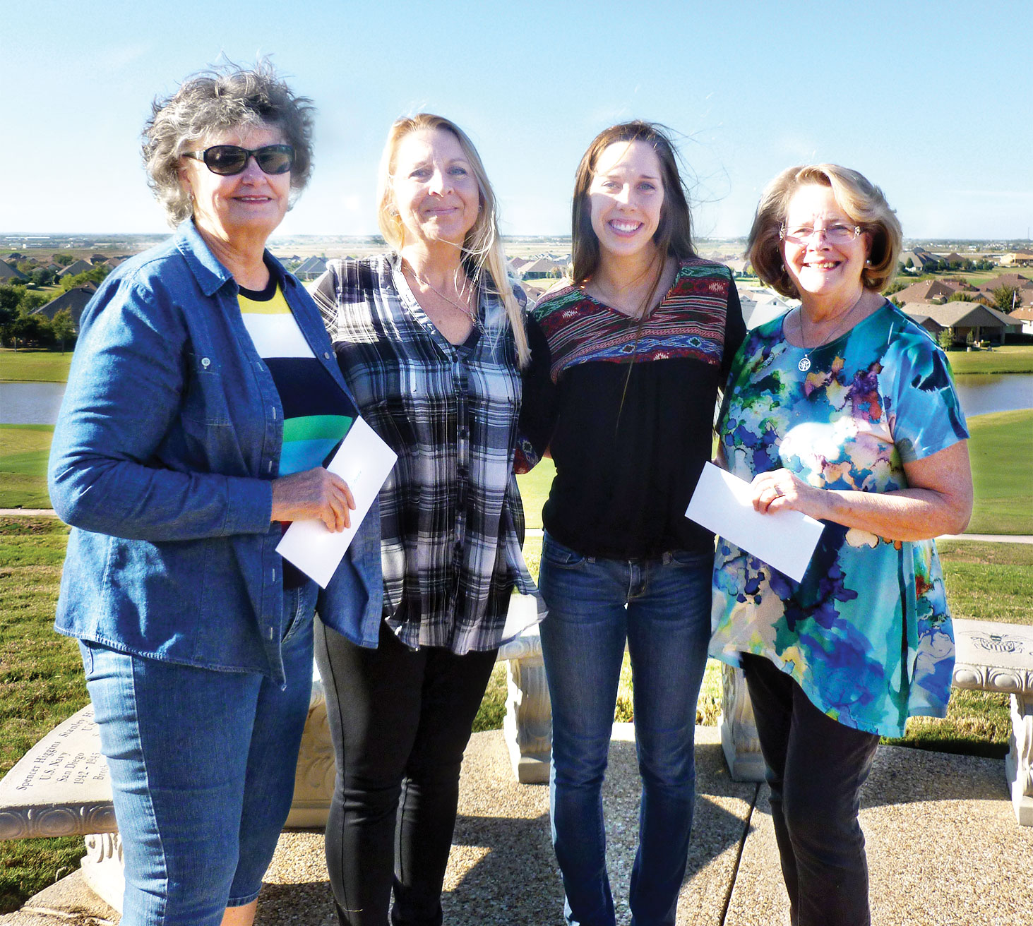 Fellowship at the Ranch Church members Doris Koenig, left, of Robson Ranch and Edie Jones, far right, present Lynnie Anderson, City Director, second from left, and Lexie Chamberlain, volunteer, a check from Fellowship at the Ranch.