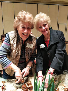 Bev Clegg and Elizabeth Olson plant paper whites; photo by Janie Cindric