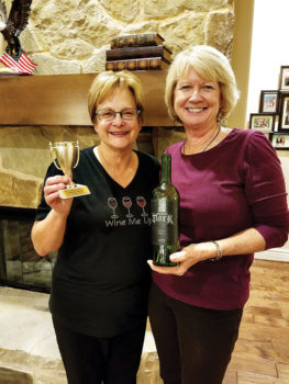 Cindi Stampf and Janie Farnsworth with the winning wine.