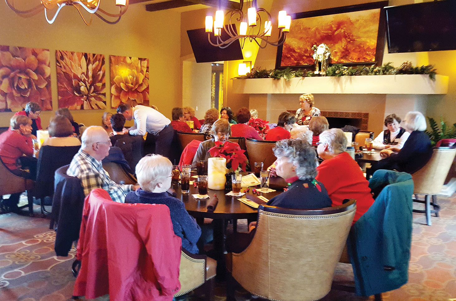 Library volunteers enjoy lunch and holiday decorations at the Wildhorse Grill.
