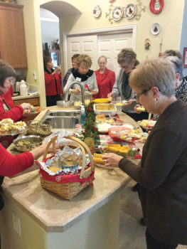 Ladies lunching: Peggy Zilinsky, Karen Solomon, Jacqueline Geist, Jan Wallace, Jois Ross, Nancy Myers and forefront Carol Hansen