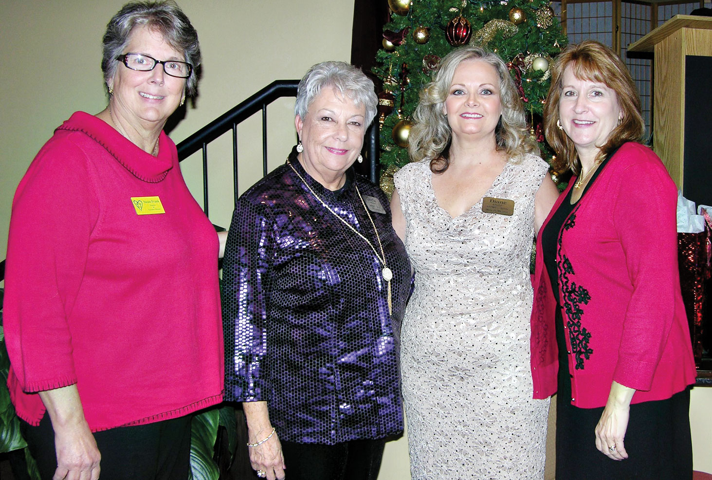 Diane Khalar and Darla Mahan with a representative from the Monsignor King Outreach Center of Denton and Hearts for Homes.