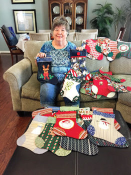 Judy Riffel with Christmas Stockings