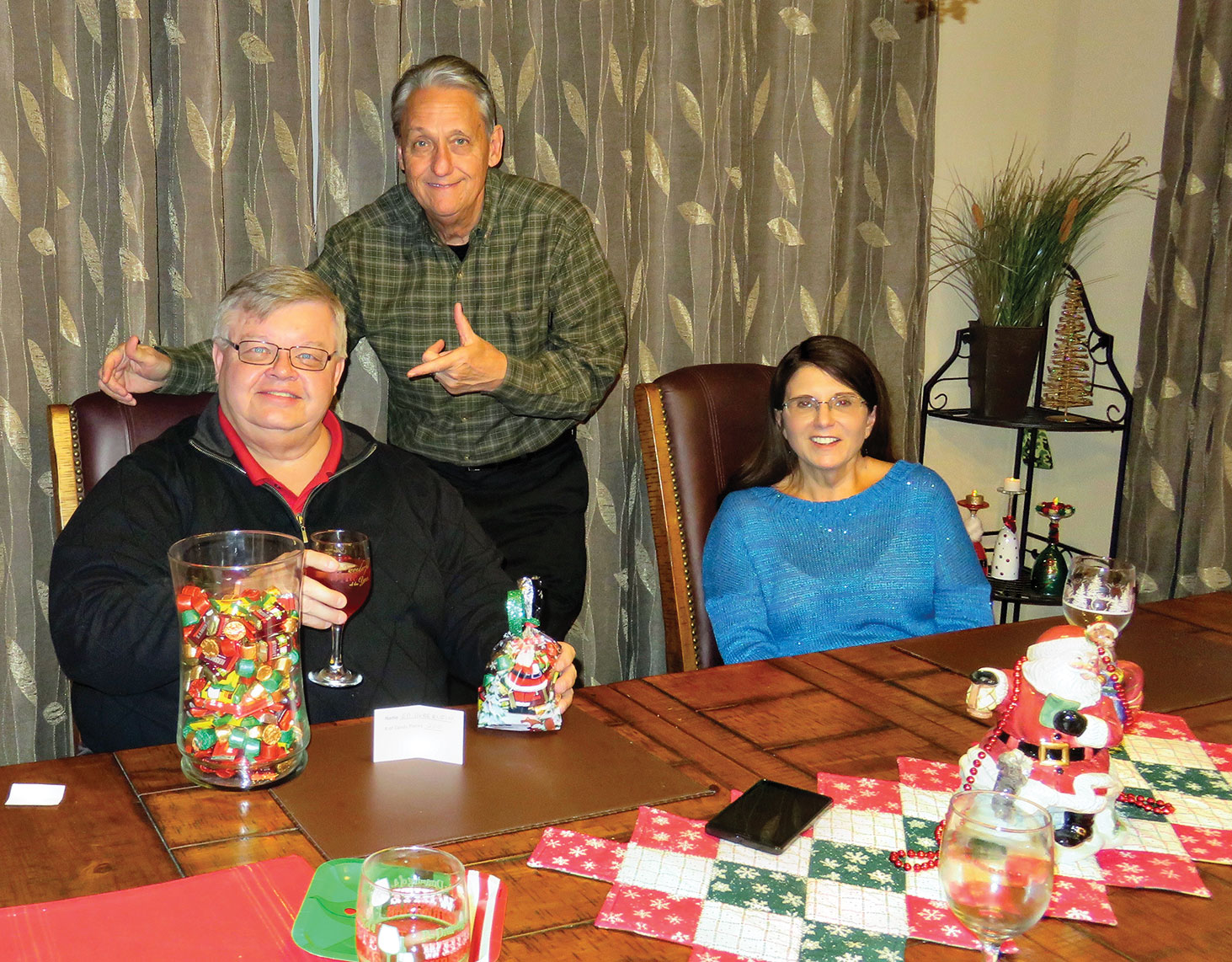 Bobby Rogers presents the prize! Ed Heberlein, candy count winner; host Bobby Rogers and Kathy Heberlein.