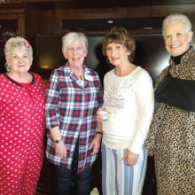 Former Queens Jan Utzman, Nanci Zipes and Glenda Brown gather to discuss club activities with current Queen Phyllis Ayers (second from right).