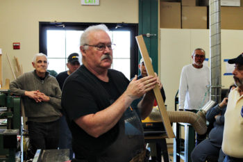 David Basham teaches a woodworking class.