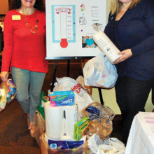 Judy Ondina, Service, and Randi Skinner, Friends of the Family, with donations from members