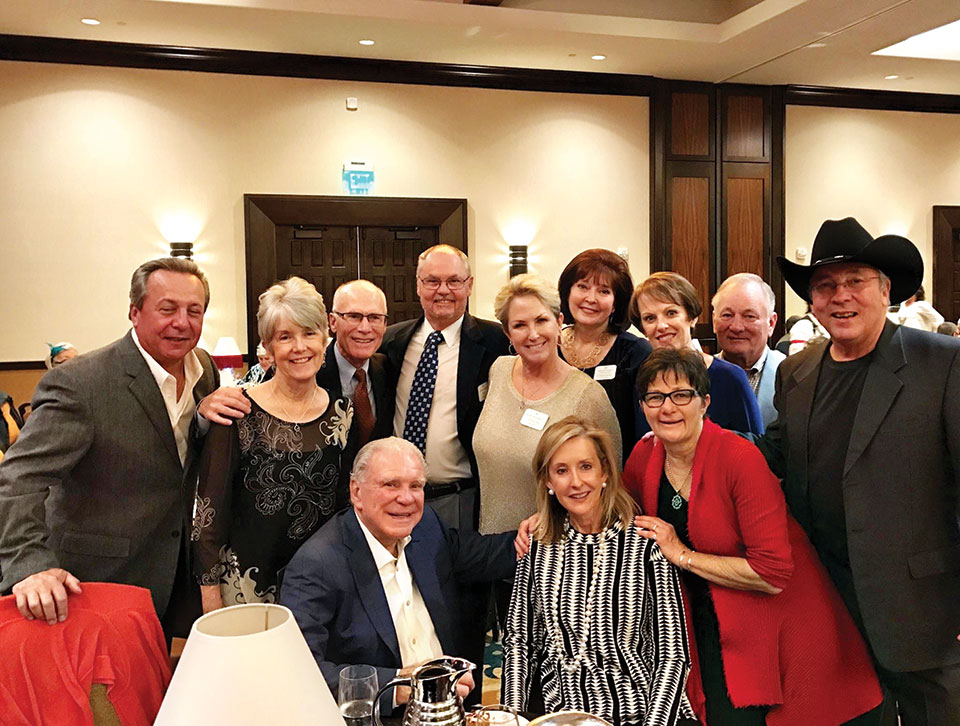 Top row: Carl Caruso, Marsha and Terry Scholze, Phil and Donna Harper, Charlotte Caruso, Dianne and Tim Battle, John Harnly; bottom row: Mr. Robson, Karen Taylor, Marti Harnly