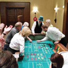 Ken Kruzel (in the big green Irish hat!) getting ready to roll the dice in Craps