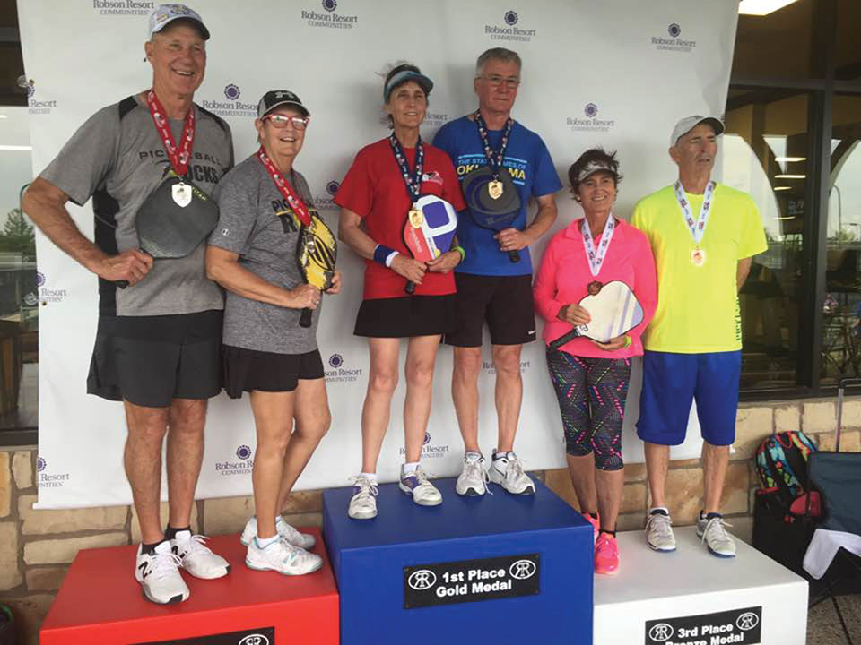 Mixed Doubles 65+ 5.0, 4.5 medal winners from left to right: Fred Thompson (resident) and Vicky Noakes, Silver Medal; Susan Goldstraw and Rick Mendenhall, Golf Medal; Sherril Kerr (resident) and Tim Kuss, Bronze Medal