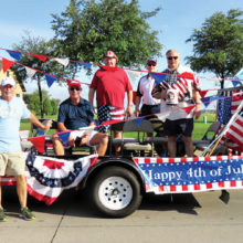 The Brothers of Sigma Chi and their 4th of July float