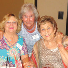 Happiness is catching up with friends at the Women's Club luncheon.