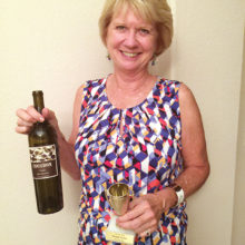 August winner Cyndi Stampf with a 2015 Red Blend from Cocobon Estates