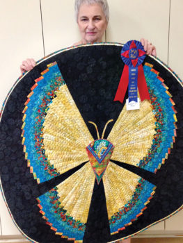 Marguerite Rose and her butterfly quilt