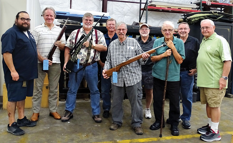 """Left to right: """"Poochie"""" (Shilen tour guide), Russ Bafford, Andy Cartwright, Stephen Pettigrew, Dave MacDonald, Kelly Petre, Ed Schmidt, Larry Hampton and Dick Remski"""