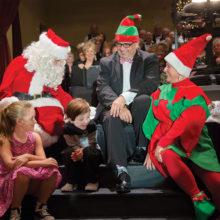 Choir Director Dr. Arturo Ortega looks on as Santa visits Christmas at the Ranch 2016.