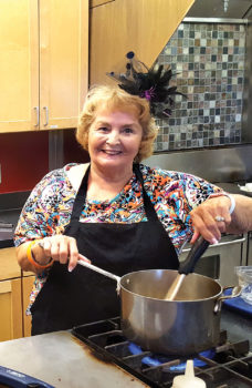 Betty Gardner stirs the simmering honey, orange and rosemary infusion for the baklava.