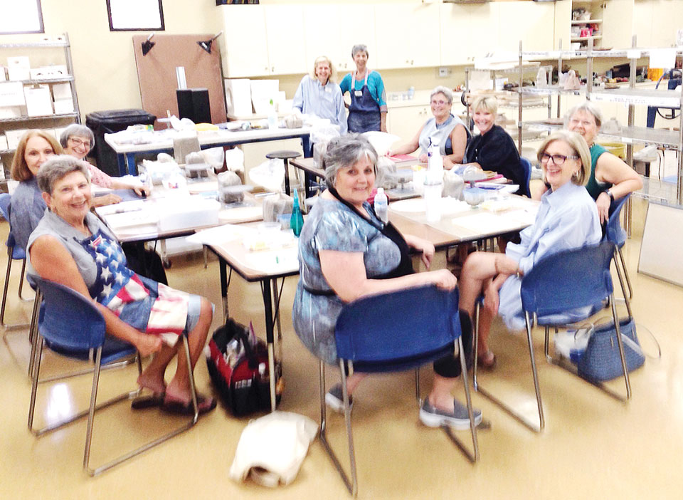 Instructor Pat Bender; President Judie Smothers; Table, left to right: Mimi Mancuso, Betha K. Stanndard, assistant Jackie Graham, Cindy Molello, Karla Bennetson, assistant Carolyn Detjen, Nancie Garre, Barb Bennet