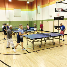 Farmers Branch and Robson Ranch Table Tennis Clubs' members enjoy match play.