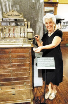 Bernadette Fideli is making change at the antique cash register.