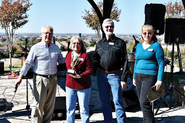 Pastor Ed Jones, cook-off winners Carolyn and Wayne Detjen, and Cynthia Drury