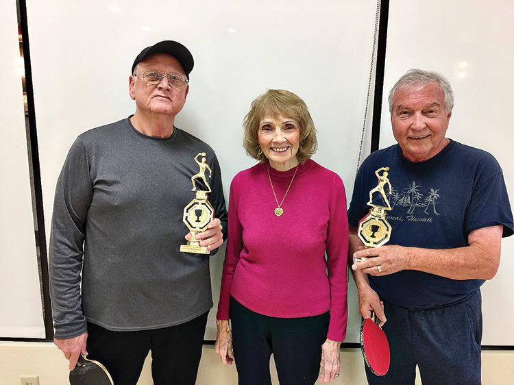 "Arlene Pfeil (center) with the winners of 2019 Arlene Pfeil/Jim Greg Doubles Tournament Jim ""Butch"" Southard and Peter Hollatz"